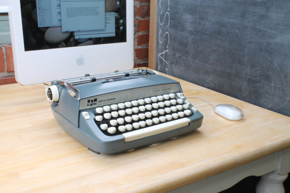 computer and typewriter Typewriter inspired usb/bluetooth mechanical keyboard with integrated tablet stand, dual scroll wheels and macro programmable return bar.
